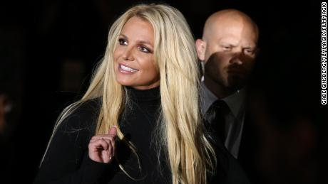 Some of her supporters suggesting they are at a treatment facility against a social media campaign with the hashtag #FreeBritney. Britney Spears at the event in 2018