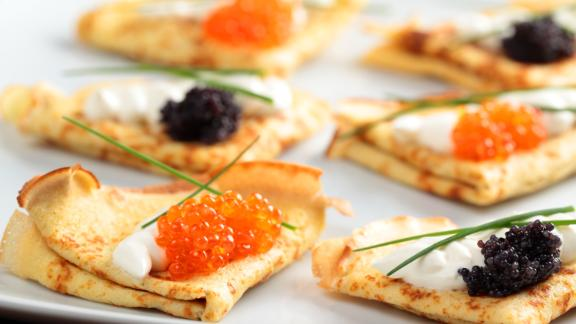 Russia: Blinis with red and black caviar on a plate may sound indulgent, but it