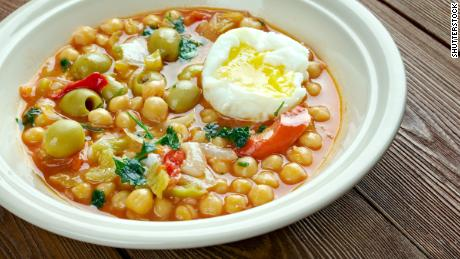 Lablabi - Tunisian dish based on chick peas. Raw or soft-cooked egg ,mix along with olive oil, harissa, and sometimes olives, garlic and vinegar