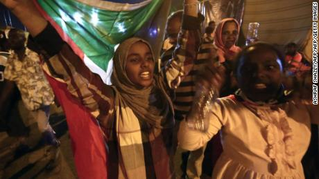 TOPSHOT - Sudanese protestors celebrate after an agreement was reached with the military council to form a three-year transition period for transferring power to a full civilian administration, in Khartoum, early on May 15, 2019. - The protest movement is demanding a civilian-led transition following 30 years of iron-fisted rule by now deposed president Omar al-Bashir, but the generals who toppled him have been holding onto a leadership role. (Photo by ASHRAF SHAZLY / AFP)        (Photo credit should read ASHRAF SHAZLY/AFP/Getty Images)
