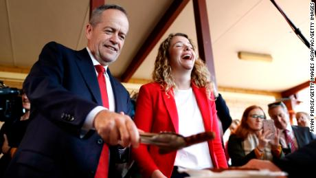 Labor Leader Bill Shorten and Labor Candidate for Boothby Nadia Clancy hand out sausages in Adelaide on May 14.