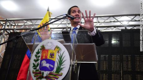 The Venezuelan opposition leader and self-declared President Juan Guaido speaks at a meeting in Caraca