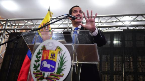 Venezuelan opposition leader and self-declared president Juan Guaido talks at a meeting in Caraca