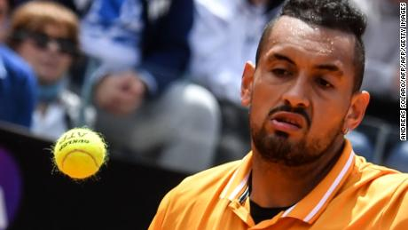 Australia's Nick Kyrgios returns the ball to Russia's Daniil Medvedev (unseen) during their ATP Masters tournament tennis match at the Foro Italico in Rome on May 14, 2019. (Photo by Andreas SOLARO / AFP)        (Photo credit should read ANDREAS SOLARO/AFP/Getty Images)