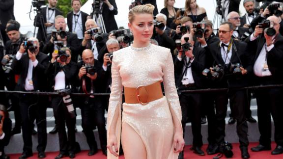 """Amber Heard wears a sequined dress, accessorized with a wide leather belt and Chopard jewelry, to the screening of """"Les Miserables"""" on day two of Cannes Film Festival."""