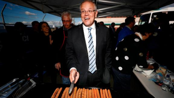 Scott Morrison, Prime Minister of Australia, cooks sausages during a Liberal Party Campaign Rally at Launceston Airport on April 18, 2019