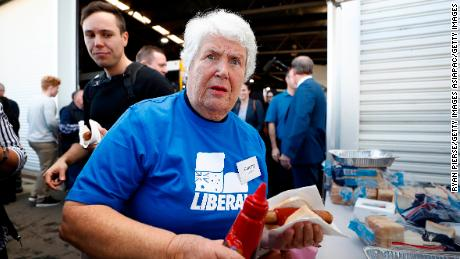 Liberal Party supporter Dorothy Dehais has a sausage during a campaign rally at Launceston airport on April 18.
