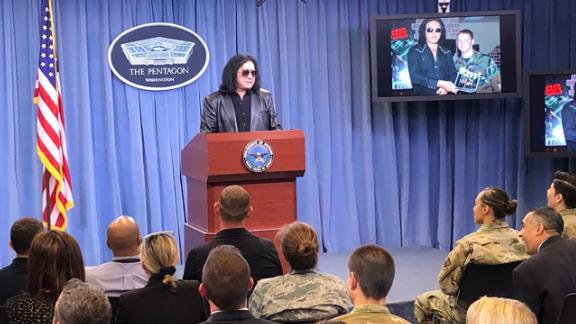 Gene Simmons at the Pentagon Briefing Room podium (Credit: Ryan Browne and Barbara Starr)