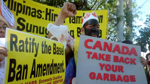 Environmental activists in Manila on September 9, 2015, demanding trash be shipped back to Canada.