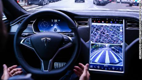 A driver rides hands-free in a Tesla Motors Inc. Model S vehicle equipped with Autopilot hardware and software in New York, U.S. on Monday, Sept. 19, 2016. The latest overhaul of the car's operating system, known as Tesla 8.0, biggest change is how Autopilot shifts towards a heavier reliance on its radar than its camera to guide the car through traffic. Photographer: Christopher Goodney/Bloomberg via Getty Images