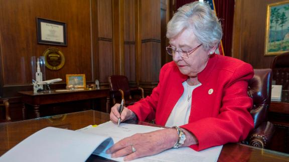 This photograph released by the state shows Alabama Gov. Kay Ivey signing a bill that virtually outlaws abortion in the state on Wednesday, May 15, 2019, in Montgomery, Ala. Republicans who support the measure hope challenges to the law will be used by conservative justices on the U.S. Supreme Court to overturn the Roe v. Wade decision which legalized abortion nationwide. (Hal Yeager/Alabama Governor