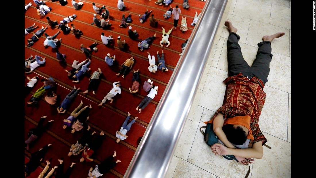 "Muslim men rest after attending Friday prayers May 10 at the Istiqlal Mosque in Jakarta, Indonesia. During <a href=""http://www.cnn.com/2019/05/06/world/gallery/ramadan-2019/index.html"" target=""_blank"">the Islamic holy month of Ramadan,</a> Muslims fast from dawn until sunset."