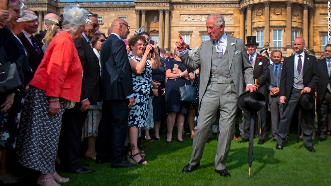 Britain's Prince Charles greets guests at the Queen's Garden Party at Buckingham Palace on Wednesday, May 15.