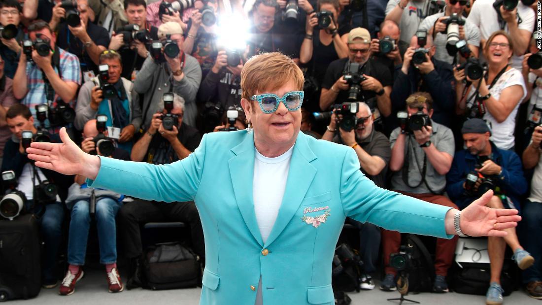 "Singer Elton John poses for photographers at the Cannes Film Festival on Thursday, May 16. The festival was screening the John biopic ""Rocketman,"" starring Taron Egerton."