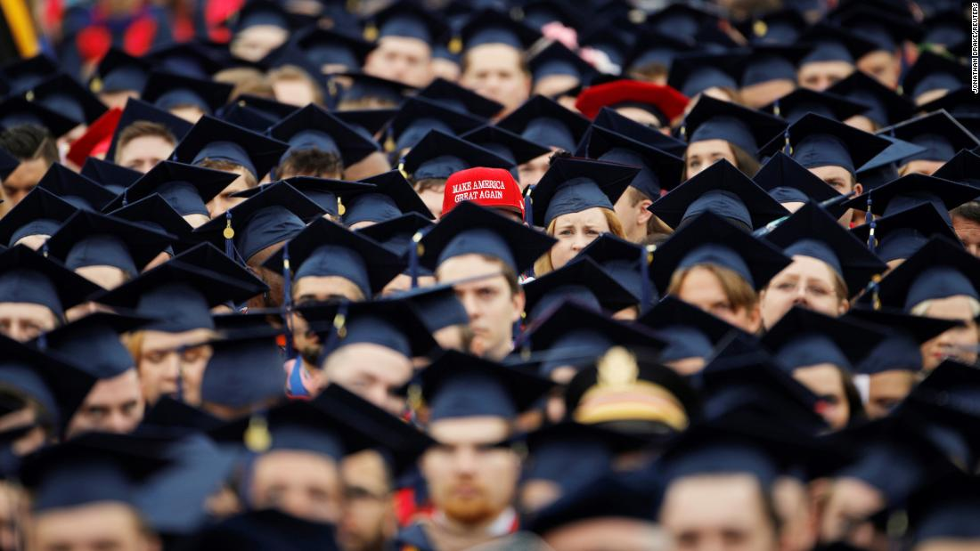 "A graduate wears a ""Make America Great Again"" hat at commencement ceremonies held Saturday, May 11, at Liberty University in Lynchburg, Virginia."