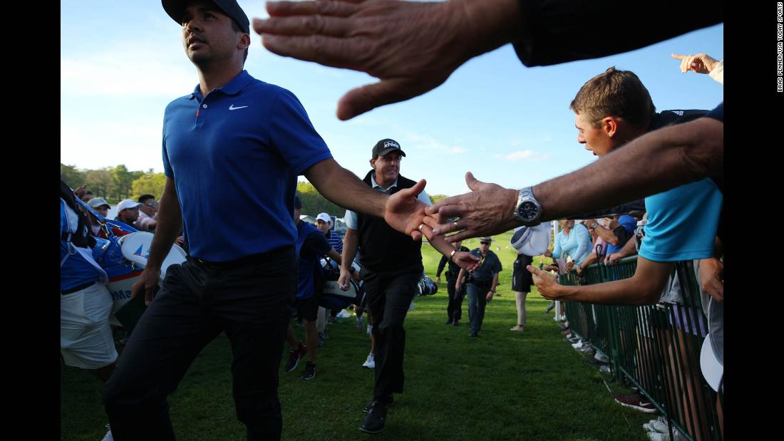Phil Mickelson and Jason Day salute their fans as they complete solid first rounds of 1 under par.