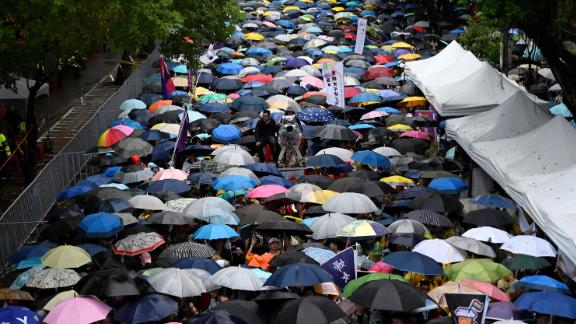Gay rights supporters wait in the rain outside the parliament building in Taipei before the landmark decision was announced on Friday.