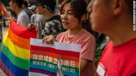 TAIPEI, TAIWAN - MAY 16: LGBT rights protesters demonstrate outside a parliamentary administration building where politicians are continuing to discuss same-sex marriage bills ahead of a vote on Friday, on May 16, 2019 in Taipei, Taiwan. Taiwan's parliament on Tuesday began efforts to reconcile three competing bills on same-sex marriage that will determine how same-sex relationships are defined in the future. The conclusions reached during Tuesday's negotiations are expected to be put to a parliamentary vote on May 17. Implementation of the bill put forward by the executive branch of the government, or a failure to deliver a bill, would see Taiwan becoming the first country in Asia to legalise same-sex marriage. (Photo by Carl Court/Getty Images)