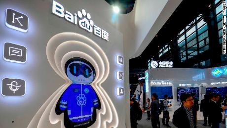 This photo taken on November 6, 2018 shows a man walking past a booth of Baidu at the Light of Internet Expo ahead of the 5th World Internet Conference in Wuzhen in China's eastern Zhejiang province. (Photo by STR / AFP) / China OUT        (Photo credit should read STR/AFP/Getty Images)
