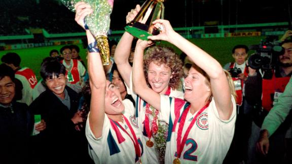 Michelle Akers-Stahl (C), Julie Foudy (L) and Carin Jennings (R) celebrate winning the first Women's World Cup held in 1991.