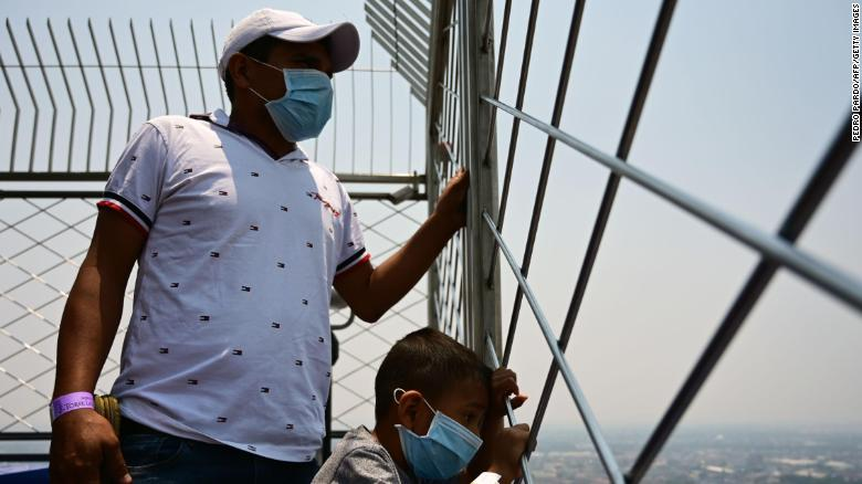 Visitors enjoy the view --despite air pollution -- from the Latin American tower viewpoint in Mexico City on May 14, 2019.