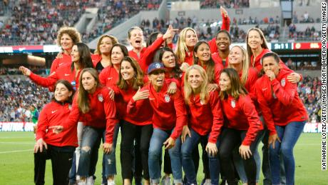 Members of the 1999 Women's World Cup-winning team pose for a photo at halftime of a game between U.S. Women and Belgian Women at Banc of California Stadium on April 07, 2019 in LA.