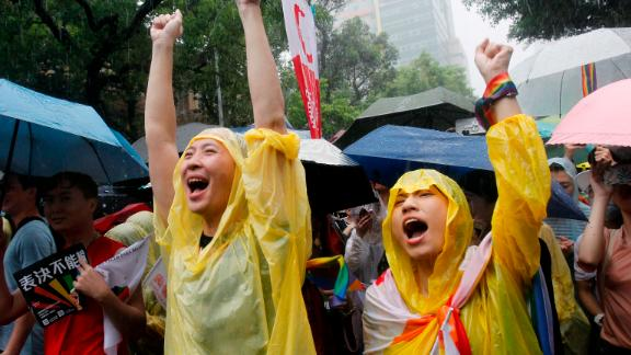 Same-sex marriage supporters cheer outside the Legislative Yuan in Taipei, Taiwan, on May 17, 2019 after Taiwan's legislature passed a law allowing same-sex marriage.