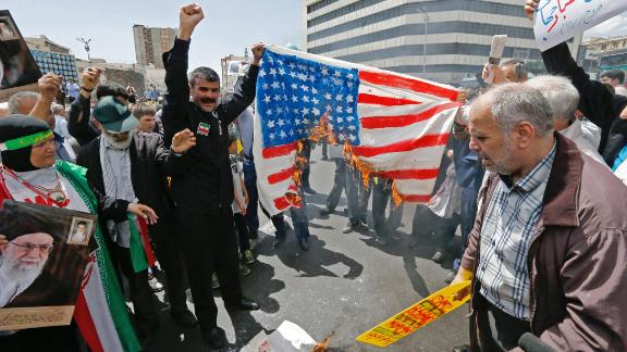 "Iranian demonstrators burn a makeshift US flag during a rally in the capital Tehran, on May 10 2019. - Iranian foreign minister blamed the EU for the decline of Tehran's nuclear accord with world powers and insisted the bloc ""should uphold"" its obligations under the pact in which Iran agreed to curb its nuclear ambitions in return for sanctions relief. US President Donald Trump pulled the United States out of the agreement in May of last year and reinstated unilateral economic sanctions. (Photo by STR / AFP)        (Photo credit should read STR/AFP/Getty Images)"