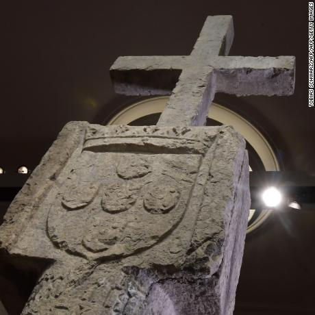 A picture taken on May 17, 2019 in Berlin shows a Stone Cross, a key 15th-century navigation landmark erected by Portuguese explorers, seen at the History Museum in Berlin. - The History Museum museum announced it would restitute the cross to Namibia as part of Berlin's efforts to face up to its colonial past. Placed in 1486 on the western coast of what is today Namibia, the Stone Cross was once considered to be such an important navigation marker that it featured on old world maps. In the 1890s, it was removed from its spot on Cape Cross and brought to Europe by the region's then German colonial masters. (Photo by Tobias SCHWARZ / AFP)        (Photo credit should read TOBIAS SCHWARZ/AFP/Getty Images)
