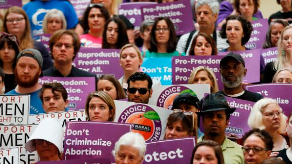 "Abortion rights supporters stand during a news conference by Presidential candidate Sen. Kirsten Gillibrand, D-N.Y., at the Georgia State Capitol in Atlanta on Thursday, May 16, 2019 to discuss abortion bans in Georgia and across the country. Georgia was the fourth state this year to pass anti-abortion ""heartbeat"" legislation, but Democratic presidential candidates have taken aim at the state"