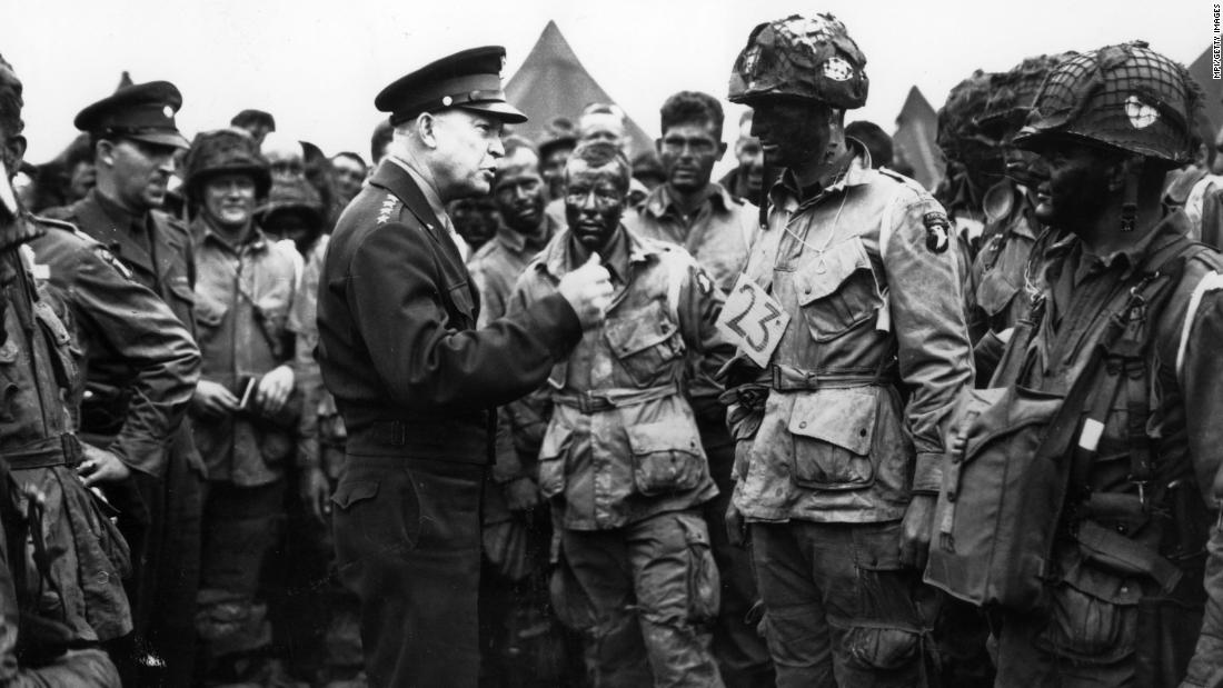 "US Gen. Dwight D. Eisenhower, supreme commander of the Allied forces, gives the order of the day to paratroopers in England. ""Full victory — nothing else"" was the command just before they boarded their planes to participate in the first wave. The invasion — code-named Operation Overlord — had been brewing for more than two years."