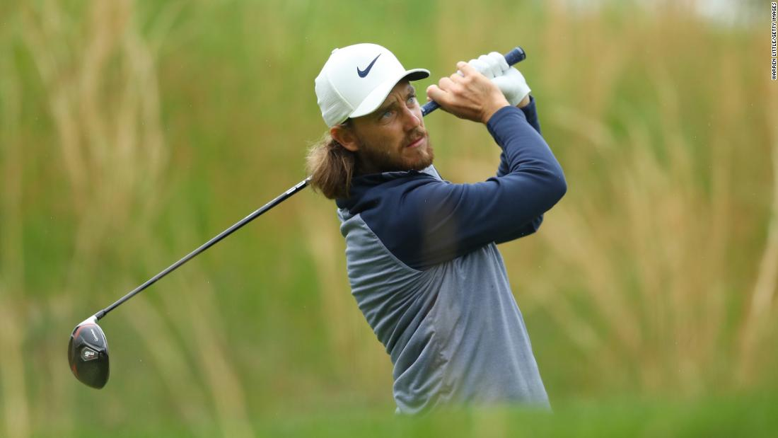 Tommy Fleetwood plays a shot from the fourth tee.