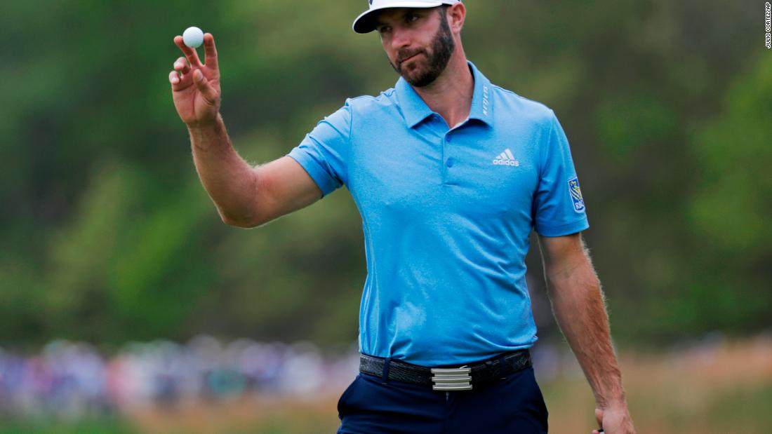 World No.1 Dustin Johnson reacts after putting on the seventh green.