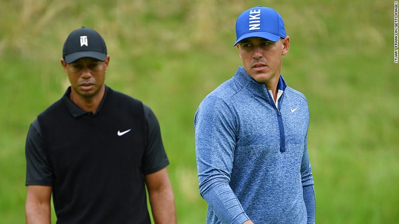 Brooks Koepka (right) stamped his authority on the US PGA as Tiger Woods toiled.