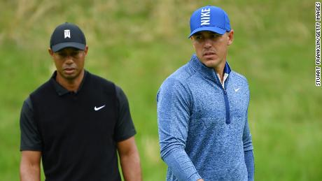 22b83c41f34ef Brooks Koepka (right) stamped his authority on the US PGA as Tiger Woods  toiled