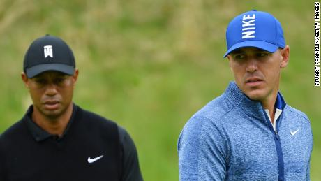 FARMINGDALE, NEW YORK - MAY 17: Brooks Koepka of the United States and Tiger Woods of the United States on the eighth green during the second round of the 2019 PGA Championship at the Bethpage Black course on May 17, 2019 in Farmingdale, New York. (Photo by Stuart Franklin/Getty Images)