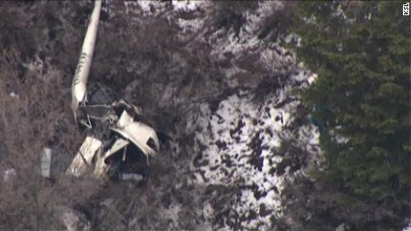 Aerial footage shows the helicopter crash site Friday  near Alpine, Utah.
