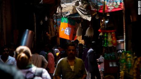 A flag of the ruling Bharatiya Janata Party (BJP) hangs over Varanasi's crowded old lanes.