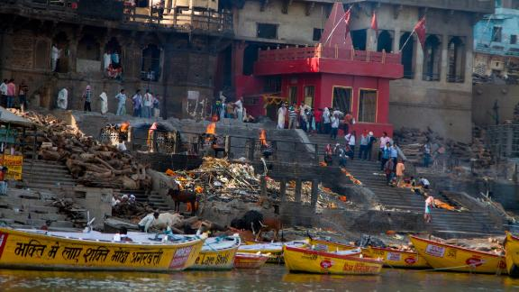 Manikarnika Ghat, one of the most sacred places in Varanasi, is where the faithful come to cremate their dead on funeral pyres, which burn 24 hours a day.