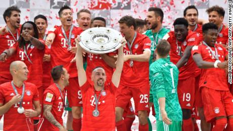 Bayern Munich players including Bayern Munich's French midfielder Franck Ribery celebrate with the trophy after the German First division Bundesliga football match FC Bayern Munich v Eintracht Frankfurt in Munich, southern Germany,  on May 18, 2019. (Photo by John MACDOUGALL / AFP) / DFL REGULATIONS PROHIBIT ANY USE OF PHOTOGRAPHS AS IMAGE SEQUENCES AND/OR QUASI-VIDEO        (Photo credit should read JOHN MACDOUGALL/AFP/Getty Images)