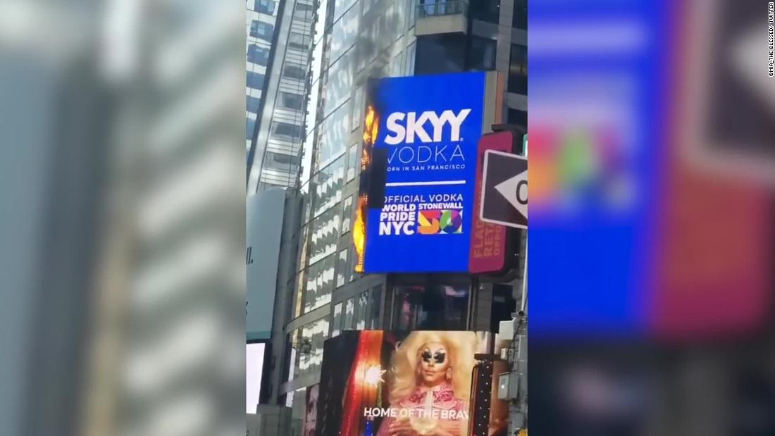 A billboard in Times Square caught fire