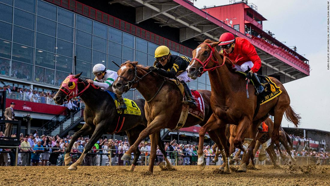 Lexitonian with jockey Jose Ortiz, center, defeats Gladiator King to win the Chick Lang Stakes at Pimlico Race Course on Saturday.