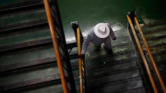 A spectator takes a staircase at Pimlico Race Course ahead of the Preakness Stakes horse race in Baltimore on Saturday.