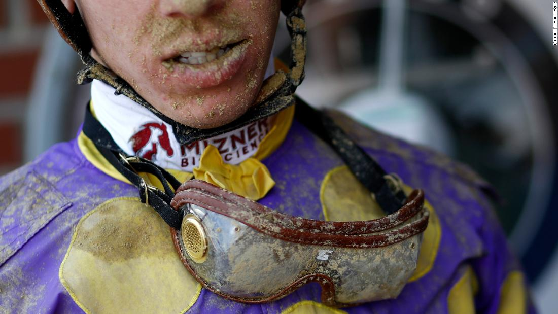 Dirt sticks to jockey Tyler Gaffalione's goggles following the day's eighth race at Pimlico Race Course, ahead of the Preakness Stakes in Baltimore.