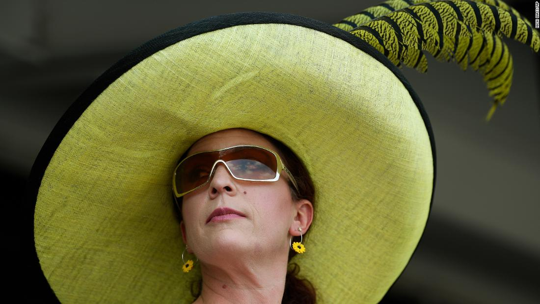 Collette Tipton of Baltimore watches race 6 ahead of the 144th Preakness Stakes horse race at Pimlico Race Course.