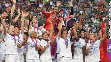 Lyon players celebrate with the trophy after the UEFA Women's Champions League final football match Lyon v Barcelona in Budapest on May 18, 2019. (Photo by Attila KISBENEDEK / AFP)        (Photo credit should read ATTILA KISBENEDEK/AFP/Getty Images)
