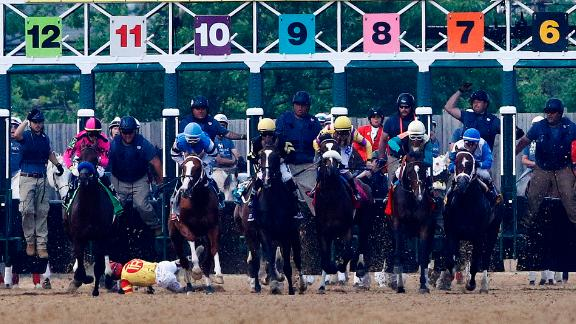 John Velazquez tumbles to the turf after falling off Bodexpress at the starting gate during the 144th Preakness Stakes horse race at Pimlico on Saturday.