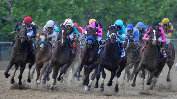 War of Will, at right, rounds the fourth turn to win the 144th running of the Preakness Stakes at Pimlico Race Course on Saturday.