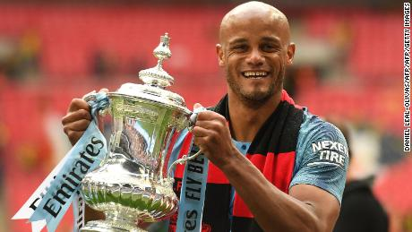 Manchester City's Belgian captain Vincent Kompany holds the winner's trophy after the English FA Cup final football match between Manchester City and Watford at Wembley Stadium in London, on May 18, 2019. - Manchester City beat Watford 6-0 at Wembley to claim the FA Cup. (Photo by Daniel LEAL-OLIVAS / AFP) / NOT FOR MARKETING OR ADVERTISING USE / RESTRICTED TO EDITORIAL USE        (Photo credit should read DANIEL LEAL-OLIVAS/AFP/Getty Images)