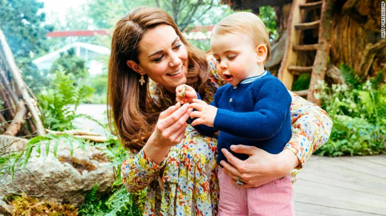 Britain's Duchess of Cambridge and her son Prince Louis play in a new garden co-designed by Kate.